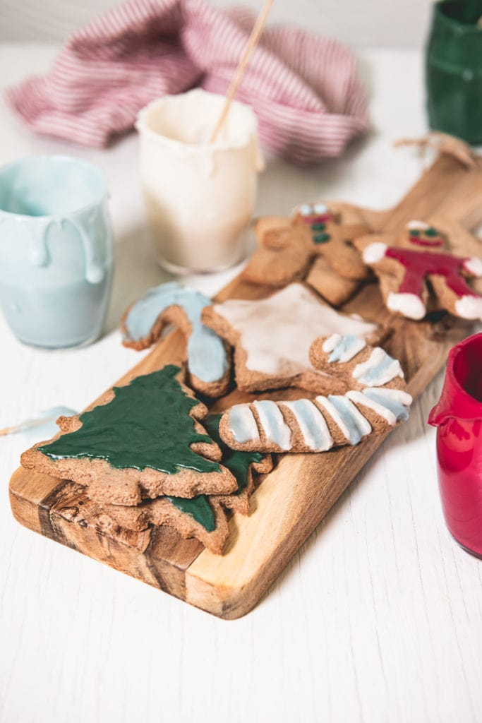 An assortment of Crunchy Gluten-free Gingerbread Cookies decorated with naturally coloured eggless royal icing