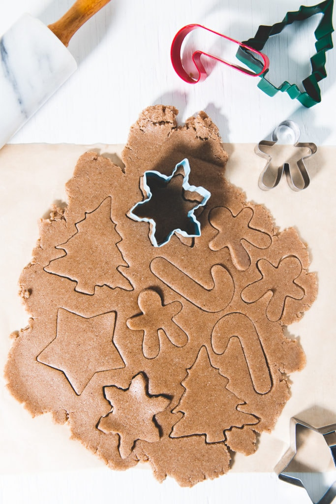 Crunchy Gluten-Free Gingerbread Cookie dough rolled out and filled with holiday shaped cut outs.