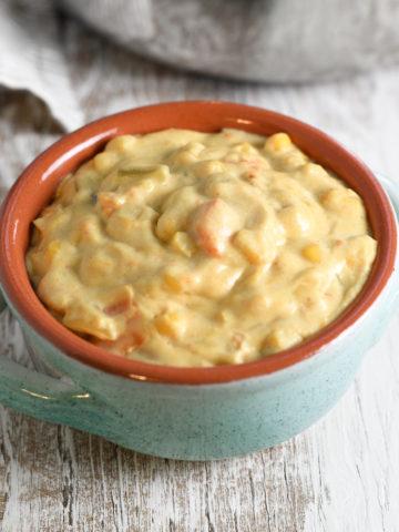 A bowl of hearty sweet potato corn chowder.